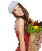 Mujer joven con una bolsa de compras de comestibles. backg aislado en blanco — Foto de Stock