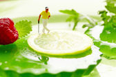 Miniature golf on fruits — Stock Photo