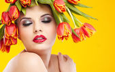 Beauty woman portrait with wreath from flowers on head ogange b — Stockfoto