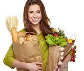 Jonge vrouw met een boodschappentas kruidenier. geïsoleerd op witte backg — Stockfoto