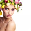 Fashion model with large hairstyle and flowers in her hair. — Stock Photo #24740561