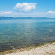 Water surface in a blue morning on the Trasimeno lake - Stock Photo
