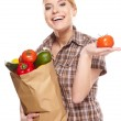Young woman with a grocery shopping bag. — Stock Photo #24838443