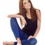 Beautiful brunette woman sitting on the floor . Studio shoot. — Stock Photo #24839057
