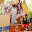 Young beautiful woman with packages for house moving — Stock Photo #24839385
