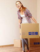 Young beautiful woman with packages for house moving — Stock Photo