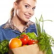 Young woman with a grocery shopping bag — Stock Photo