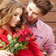 Stock Photo: Beautiful couple in love with rose