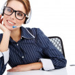 Headset. Customer service operator woman with headset smiling lo - Stock Photo