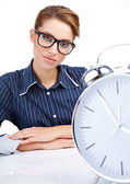 Young attractive woman with big clock on white. — Stock Photo