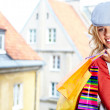 Young blonde shopping woman with bags — Stock Photo #24912311