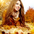 Autumn woman on leafs — Stock Photo