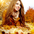 Autumn woman on leafs - Stock Photo