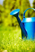 Watering can in garden — Stock Photo