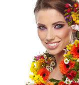 Portrait of a woman dressed in spring flowers — Stock Photo
