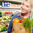 Royalty-Free Stock Photo: Woman shopping for fruits and vegetables in produce department