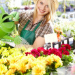 Young blond girl with gardening tools — Stock Photo