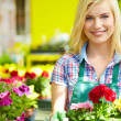 Woman holding a flower box while smiling  — Stock Photo