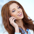 A beautiful young real estate agent woman on the phone — Stock Photo #25380699