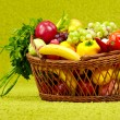 Basket full of fresh produce. green background — Stock Photo #25380491
