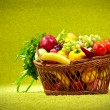 basket full of fresh produce. green background — Stock Photo