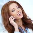 A beautiful young real estate agent woman on the phone - Stock Photo