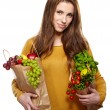Young woman with a grocery shopping bag — Stok fotoğraf