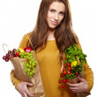 Young woman with a grocery shopping bag — Стоковая фотография
