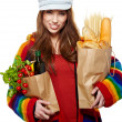 Young woman holding a grocery bag full of bread  — Stok fotoğraf