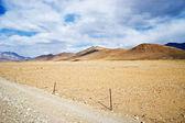 Yellowish mountain road view in tibet of China — Stock Photo