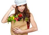 Mutlu genç erkek bir alışveriş çantası elinde — Stok fotoğraf