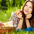 Portrait of beautifu young woman with a basket of fruit — Stock Photo #25675525