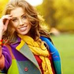 Fashion woman walking in autumn park — Stock Photo #25675559