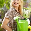 Female florist or gardener in flower shop or nursery - Photo