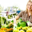 Female florist or gardener in flower shop or nursery — Stock Photo #25911713