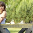 Portrait of a sexy young female smiling in a park - Outdoor — Stock Photo