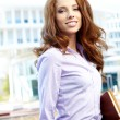 Attractive business women over modern street background — Stock Photo