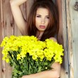 Beautiful spring woman with flowers — Stock Photo