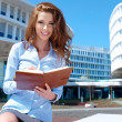 Foto Stock: Businesswoman outside a modern office building