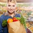 Woman shopping for fruits and vegetables — Stock Photo