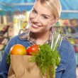 Woman shopping for fruits and vegetables — Стоковая фотография