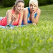 图库照片: Portrait of two fitness woman having fun in summer environment