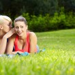 Стоковое фото: Portrait of two fitness woman having fun in summer environment