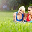 Portrait of two fitness woman having fun in summer environment — Stock fotografie #26384605