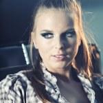 Beautiful blond model sitting on old car at night shot — Stock Photo #26447539