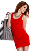 Lovely woman with shopping bags over white — Stock Photo