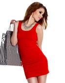 Mulher adorável com sacos de compras sobre branco — Fotografia Stock