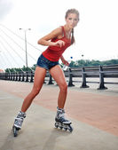 Young woman on roller skates — Stock Photo