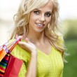 Beautiful blonde shopping woman  outdoor — Stock Photo