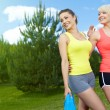 Stock Photo: Two smiling fitness girls outdoor